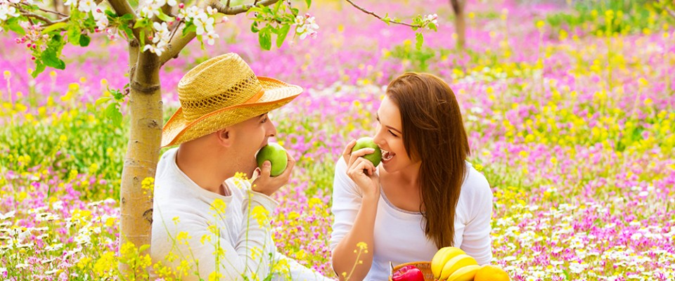 Happy couple on picnic in garden